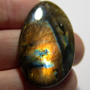 Cabochon spectrolite   42*26*6 mm,   53,8 ct
